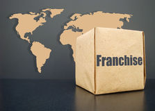 FRanchise. A franchise for the whole world. A symbol of giving a franchise Royalty Free Stock Photos