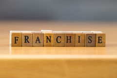 Franchise. word written on wood block. On the table royalty free stock image