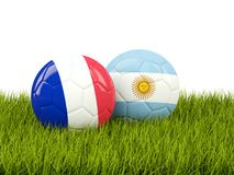 Francia contra la Argentina Concepto del fútbol Fútboles con las banderas en gre Foto de archivo