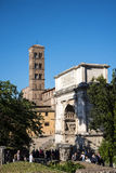 The Franciscan Church and the Arch of Titus in  the Ancient Forum in Rome Italy. Rome Italy, the Eternal city, which has been a destination for tourists since Stock Photography