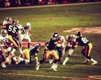 Franco Harris Pittsburgh Steelers. Steelers RB Franco Harris (32) is pursued by Ed Jones the Dallas Cowboys DL Stock Photo