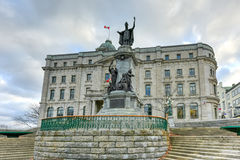 Francois de Laval Monument - Quebec City. Francois de Laval Monument, the first Roman Catholic bishop of Quebec besides the Old Post Office of Quebec City Royalty Free Stock Image