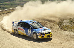 Francois Delecour on race. A Mitzubishi Lancer Evo IX driven by Francois Delecour  during the 2th stage of Nido dell'Aquila in Nocera Umbra (Italy) a competition Royalty Free Stock Images