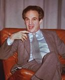 Francois Truffaut. French film director, screenwriter, actor, producer, film critic, and one of the founders of French New Wave cinema, engages in a question and stock photo