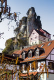 Rock formations with houses Franconian Switzerland  Germany. Bizarre columns of limestone, half-timbered houses Stock Images