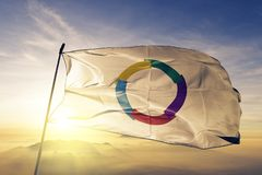Francophonie flag textile cloth fabric waving on the top sunrise mist fog