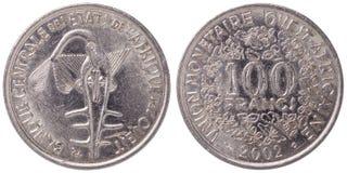 100 francos de Africa Occidental del CFA acuñan, 2002, ambos lados Imagen de archivo