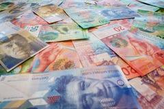 Francos suíços com vinte e cinqüênta contas novas do franco suíço Imagem de Stock