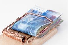 Francos suíços no mousetrap Imagens de Stock