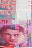 Francos suíços, um fundo do negócio imagem de stock