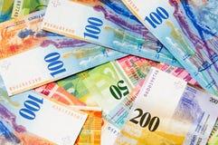 Francos suizos del dinero en circulación Fotos de archivo