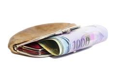 Francos suizos en la cartera aislada en blanco Foto de archivo libre de regalías