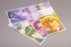 Francos suizos, moneda de Suiza Foto de archivo