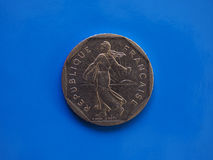 2 francs coin, France over blue Royalty Free Stock Photos