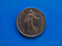 5 francs coin, France over blue Royalty Free Stock Photos