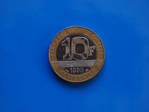 10 francs de pièce de monnaie, France au-dessus de bleu Images stock
