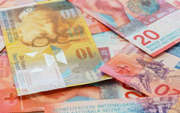 Francs suisses avec de nouvelles vingt factures de franc suisse Photographie stock libre de droits