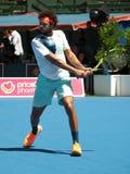 Francuski gracz w tenisa Jo-Wilfried Tsonga narządzanie dla australianu open przy Kooyong Klasycznym Powystawowym turniejem Zdjęcia Stock