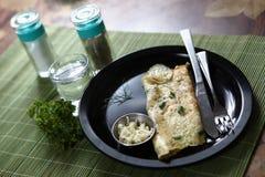 Francuski omlet, Francuski omelette, Bijący jajka smażył z masłem zdjęcia stock