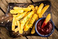 Francuzów dłoniaki na drewnianym stole Zdjęcie Stock