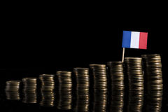 Francuz flaga z udziałem monety odizolowywać na czerni obrazy royalty free