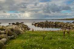 Frangiflutti, oceano e cielo a Lista in Norvegia del sud Immagini Stock Libere da Diritti