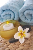 Frangipani,candle and towel on mat royalty free stock photography