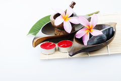 Frangipani flower with candle. Spa & aromatherapy concept. Stock Photography