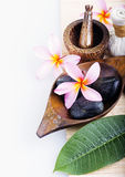 Frangipani flower with candle. Spa & aromatherapy concept. Royalty Free Stock Photos