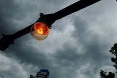 Light bulb in the rain cloud. Royalty Free Stock Image