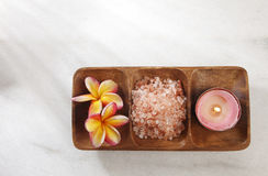 Frangipani. Flower,salt and candle in a wooden bowl stock photo