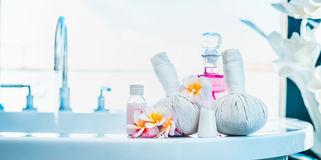 Frangipani flowers  with herbal compress stamps , pink lotion bottle on  luxury bath. Spa or wellness Stock Photo