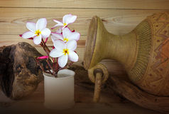 Frangipani pink flower and baked clay vase in vintage and spa st Stock Photos