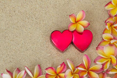 Frangipani, plumeria flowers with two red hearts Royalty Free Stock Image