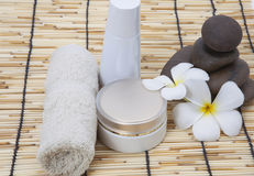 Frangipani spa set, moisturizer, polished stone. Royalty Free Stock Images
