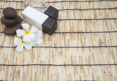 Frangipani spa set and polished stone copy space for Text Royalty Free Stock Images