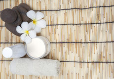 Frangipani spa set and polished stone copy space for Text Royalty Free Stock Photography