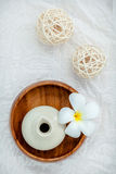 Frangipani tropical flowers with herbal spa products . Plumeria Stock Photo
