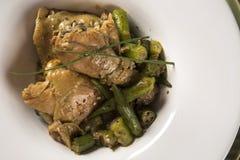 Frango com quiabo Portuguese for `chicken with okra`, Brazilian dish in white plate.  stock photo