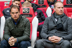 Frank de Boer and Dennis Bergkamp. NETHERLANDS, AMSTERDAM - February 21th 2016: Ajax trainer coach Frank de Boer the ArenA during Dutch Eredivisie match from Royalty Free Stock Photos