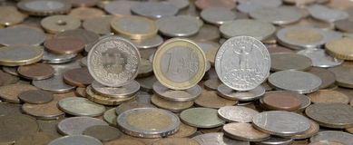 Frank, euro and dollar on background of many old coins Stock Photo