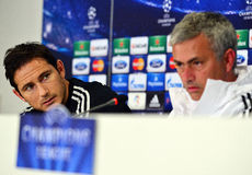 Frank Lampard during UEFA Cheampions League press conference. Chelsea's football star Frank Lampard pictured near his manager Jose ourinho during the official Stock Photography