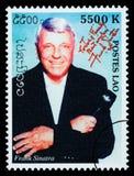 Frank Sinatra Postage Stamp. LAOS - CIRCA 200: A postage stamp printed in Laos showing Frank Sinatra, circa 2002 Royalty Free Stock Photo