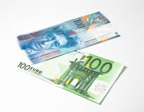 Frank up euro down. Hundred swiss franks and hundred euro Royalty Free Stock Photography