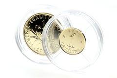 1 franka i 1 centyma złociste monety Zdjęcia Royalty Free