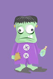 Franken baby. Baby frankenstein with bottle of milk Stock Image