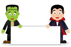 Frankenstein & Dracula with Blank Banner Stock Photos
