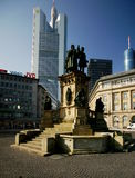 Frankfurt. Old and new monuments contrast in downtown Frankfurt, Germany. In front is the Gutenberg Monument, dedicated to the memory of the inventor of the royalty free stock photography