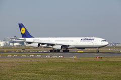 Frankfurt Airport - Airbus A340-300 of Lufthansa takes off. The Airbus A340-300 named Dueren of Lufthansa takes off at Frankfurt International Airport (Germany Stock Image