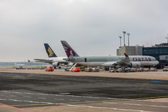 Frankfurt Apron showing A350 Qatar Airways and A380 Singapore Airlines. Frankfurt - JUNE 08, 2018: Qatar Airways A350 and Singapore A380 on apron during turn Stock Photo
